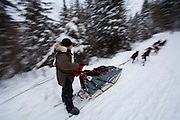 Beargrease, nws, lynn, 1.-The 28th running of the John Beargrease sled dog marathon. Mushers from all over north America including 5 teams from Wisconsin race in the annual Beargrease. The sled dog race is a marathon from Deluth MN through some of the most beautiful and rugged wilderness in North America the Boundary Waters. Fans of the race winter camp along the trail cheering and supporting their teams. <br /> The race is a tribute to Native American John Beargrease who grew up in the region. For almost twenty years, between 1879 and 1899, John Beargrease and his brothers delivered the mail between Two Harbors and Grand Marais. With the limited equipment available and loads weighing as much as 700 lbs. The trip was made once a week&hellip;an incredible feat for one man to accomplish especially when you consider the constant range of altitude along the shore.  Photo by Tom Lynn/TLYNN@JOURNALSENTINEL.COM