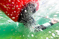 Water bubbles form an interesting perspective as shot form underwater as a kayaker performs a Kayak roll. Courtenay, The Comox Valley, Vancouver Island, British Columbia, Canada.