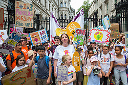 London, UK. 5 July, 2019. Jess Phillips, Labour MP for Birmingham Yardley, joins hundreds of parents and children at a protest organised by the Save Our Schools campaign group outside Downing Street against schools being forced to close early on Fridays due to funding cuts and to highlight the government's responsibility to care for and educate the nation's children on Friday afternoons. Her son Danny's school will close early on Fridays due to funding cuts from September.