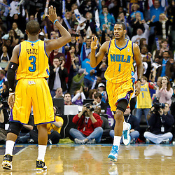 January 22, 2011; New Orleans, LA, USA; New Orleans Hornets small forward Trevor Ariza (1) celebrates with point guard Chris Paul (3) after hitting on a three point shot during the third quarter against the San Antonio Spurs at the New Orleans Arena. The Hornets defeated the Spurs 96-72.  Mandatory Credit: Derick E. Hingle