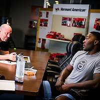 "BOCA RATON, Fla. (April 27, 2015) – MMA fighter Anthony ""Rumble"" Johnson and his manager Glenn Robinson wait for information from the UFC concerning his fight during training for his upcoming match against Jon Jones - who was replaced by Daniel Cromier after Jones' legal issues - at Jaco Hybrid Training Center in Boca Raton, Florida. (Photo by Chip Litherland for ESPN the Magazine)"