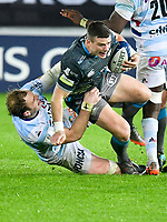 Rugby Union - 2019 / 2020 European Rugby Heineken Champions Cup - Pool Four: Ospreys vs. Racing 92<br /> <br />  Scott Williams of Ospreys tackled by Antonie Claassen of Racing, at the Liberty Stadium.<br /> <br /> COLORSPORT/WINSTON BYNORTH