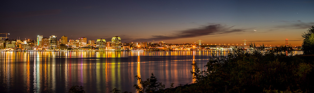 Halifax, Nova Scotia  about 45 minutes after sunset. Downtown is on the left, and the MacDonald Bridge, connecting to Dartmouth can be seen on the right