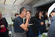 TOMAS VU-DANIEL;; SARAH SZE  , Bloomberg Venice Conversations, Siddhartha Mukherjee, Rirkrit Tiravanija and Tomas Vu Daniel cook lunch for Sarah Sze. Palazzo Peckham. Venice. Venice Bienalle. 31 May 2013