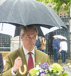 Parliament Square, Westminster, London, June 17th 2016. Following the murder of Jo Cox MP friends and members of the public lay flowers, light candles and leave notes of condolence and love in Parliament Square, opposite the House of Commons. PICTURED: Nigel Farage