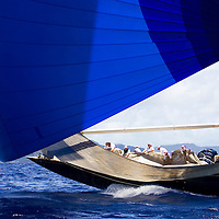 The crew wrestle with the massive head sail on the J Class yacht Valsheda at the Antigua Classic Yacht Regatta. The race is one of the worlds most prestigious traditional yacht races.