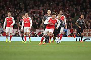 Arsenal midfielder Alex Oxlade-Chamberlain (15) dribbling away from Bayern Munich midfielder Thiago Alcantara (6) during the Champions League round of 16, game 2 match between Arsenal and Bayern Munich at the Emirates Stadium, London, England on 7 March 2017. Photo by Matthew Redman.