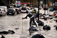 Napoli, Italia - 24 novembre 2010. Una strada allagata sulla quale galleggiano rifiuti ad Agnano, periferia di Napoli.Ph. Roberto Salomone Ag. Controluce.ITALY - Piles of uncollected garbage are seen floating in a flooded street  downtown Naples on November 24, 2010.