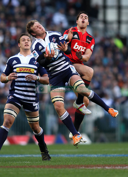 Stormers eighthman Nick Koster wins the high ball from Crusaders wing Sean Maitland during the Super Rugby Semi-Final match between DHL Stormers and the Crusaders held at DHL Newlands Stadium in Cape Town, South Africa on 2 July 2011...Photo by Shaun Roy / Sportzpics.net