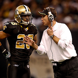 November 21, 2010; New Orleans, LA, USA; New Orleans Saints defensive backs coach Dennis Allen talks with safety Usama Young (28) during the second half against the Seattle Seahawks at the Louisiana Superdome. The Saints defeated the Seahawks 34-19. Mandatory Credit: Derick E. Hingle