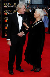 Dame Judi Dench attends The Laurence Olivier Awards at the Royal Opera House, London, United Kingdom. Sunday, 13th April 2014. Picture by i-Images