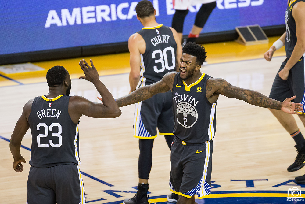 Golden State Warriors center Jordan Bell (2) and Golden State Warriors forward Draymond Green (23) celebrate during a time out against the Houston Rockets during Game 4 of the Western Conference Finals at Oracle Arena in Oakland, Calif., on May 22, 2018. (Stan Olszewski/Special to S.F. Examiner)