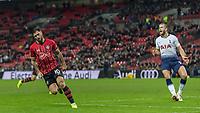 Football - 2018 / 2019 Premier League - Tottenham Hotspur vs. Southampton <br /> <br /> Charlie Austin (Southampton FC ) turns away after scoring as Eric Dier (Tottenham FC) protests to the linesman at Wembley Stadium.<br /> <br /> COLORSPORT/DANIEL BEARHAM