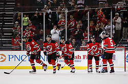 Feb 5, 2010; Newark, NJ, USA; New Jersey Devils left wing Ilya Kovalchuk (17) skates off after assisting a goal by New Jersey Devils center Dainius Zubrus (8) during the first period at the Prudential Center.