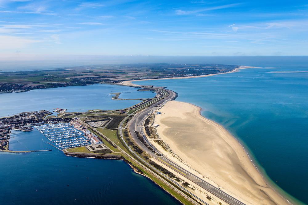 Nederland, Zeeland, Gemeente Schouwen-Duiveland, 01-04-2016; Brouwersdam, onderdeel van de Deltawerken, tussen Goeree en Schouwen-Duiveland (aan de horizon). Na het afsluiten van de zeearm Grevelingen is het Grevelingenmeer ontstaan, links van de dam, het grootste zoutwatermeer van West-Europa. Rechts de Noordzee, in het midden Middelplaat en recreatiecentrum en vakantiepark Port Zelande. <br /> <br /> Brouwers dam, part of the Delta Works, between Goeree and Schouwen-Duiveland (on the horizon). Closing the estuary resulted in the Grevelingen lake, the largest saltwater lake in Western Europe.<br /> <br /> luchtfoto (toeslag op standard tarieven);<br /> aerial photo (additional fee required);<br /> copyright foto/photo Siebe Swart