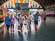 16 APRIL 2014 - BANGKOK, THAILAND: Passengers arriving in Bangkok walk through Hua Lamphong Railway Station, the main train station in Bangkok. Thai highways, trains and buses were packed Wednesday as Thais started returning home after the long Songkran break. Songkran is normally three days long but this year many Thais had at least an extra day off because the holiday started on Sunday, so many Thais started traveling on Friday of last week.    PHOTO BY JACK KURTZ