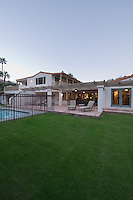 Lawn and swimming pool of Palm Springs home exterior