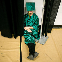 Borah High School senior James DeMorest finds a quite place to relax before commencement ceremonies at Taco Bell Arena. Borah students took 525 advanced placement tests this school year, which puts them 2nd in the state of Idaho. The Borah Rowdies were chosen as the best student section in the state and Borah High School won the 2014-2015 5A Sportsmanship Award. Check out Treasure Valley graduation highlights at IdahoStatesman.com Friday May 29, 2015