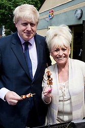 © under license to London News Pictures.  19/05/2011. LONDON, UK. Photocall for The Big Lunch. London Mayor Boris Johnson and Barbara Windsor call on Londoners to catch the street party fever. The Big Lunch is an annual one-day get together where neighbours and local communities share lunch and enjoy a street party. Last year, 800,000 people took part across the UK, over 160,000 of which were in London. Photo credit should read Bettina Strenske/LNP