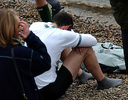 A DEJECTED CAMBRIDGE OARSMAN AFTER THE 149TH OXFORD CAMBRIDGE BOAT RACE.OXFORD BEAT CAMBRIDGE BY THE SHORTEST OF MARGINS,ONE FOOT.6.4.03.PIX STEVE BUTLER