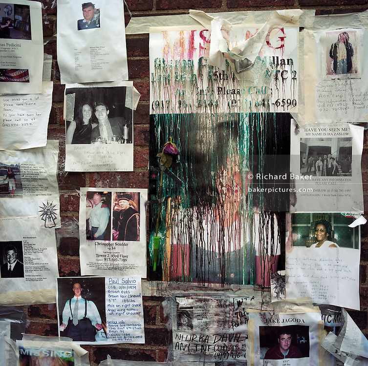 During a journey into America's hinterlands, days after the September 11th attacks in New York and Washington DC, the streets between 66th and 67th Streets, in the heart of Manhattan's Upper East Side, was a point of focus for those with missing relatives who attached thousands of posters to walls with pictures and messages to loved-ones in the hope of being reunited. DNA samples were taken at the nearby Armory so human remains might be identified. Here, the coloured ink from desktop printers prints have streaked after rain soaked the posters leaving a sense of the tragic disappearance of thousands - a haunting detail of the missing and the dead. Emotions were therefore running high and we see the sad, rain-soaked messages, the faces of happy people and their physical descriptions and contacts numbers. In most cases, these people were never seen again..