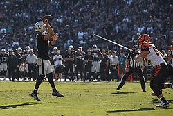 OAKLAND, CA - NOVEMBER 17: Quarterback Derek Carr #4 of the Oakland Raiders throws a touchdown pass against the Cincinnati Bengals during the second quarter at RingCentral Coliseum on November 17, 2019 in Oakland, California. The Oakland Raiders defeated the Cincinnati Bengals 17-10. (Photo by Jason O. Watson/Getty Images) *** Local Caption *** Derek Carr