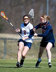 Virginia Cavaliers M Blair Weymouth (2) and Syracuse Orange Eileen Finn (18).  The #2 ranked Virginia Cavaliers women's lacrosse team defeated the #4 ranked Syracuse Orange 13-8 at the University of Virginia's Klockner Stadium in Charlottesville, VA on March 1, 2008.