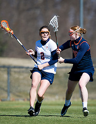 Virginia Cavaliers M Blair Weymouth (2) and Syracuse Orange Eileen Finn (18).  The #2 ranked Virginia Cavaliers women's lacrosse team defeated the #4 ranked Syracuse Orange 13-8 at the University of Virginia's Klockner Stadium in Charlottesville, VA on March 1, 2008.