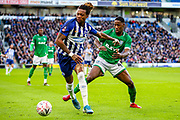 Brighton & Hove Albion defender Gaëtan Bong (3) tussles with Sheffield Wednesday defender Osaze Urhoghide (44) during the The FA Cup match between Brighton and Hove Albion and Sheffield Wednesday at the American Express Community Stadium, Brighton and Hove, England on 4 January 2020.