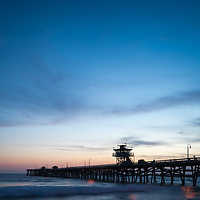 Orange County California San Clemente pier at sunset photo. Orange County is an affluent area of Southern California in the United States of America. Photo is high resolution. Copyright ⓒ 2017 Paul Velgos with All Rights Reserved.