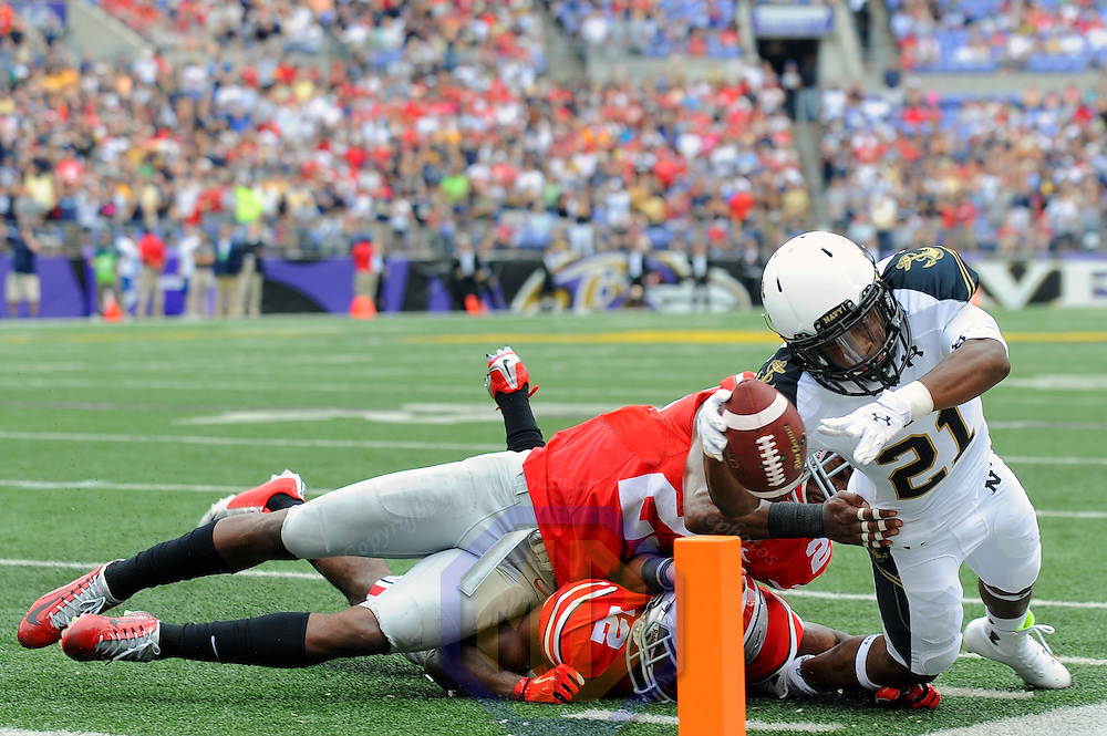 30 August 2014:   Navy Midshipmen wide receiver DeBrandon Sanders (21) scores a touchdown in action against Ohio State Buckeyes cornerback Doran Grant (12) at M&T Bank Stadium in Baltimore, MD. where the Ohio State Buckeyes defeated the Navy Midshipmen, 34-17.