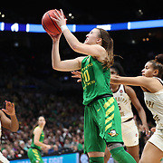 March 31, 2019; Portland, OR, USA; Oregon Ducks guard Sabrina Ionescu (20) shoots between Mississippi State Bulldogs' defenders in the Elite Eight of the NCAA Women's Tournament at Moda Center.<br /> Photo by Jaime Valdez