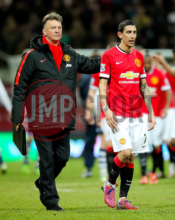 Manchester United Manager, Louis van Gaal celebrates with Angel Di Maria of Manchester United after the game - Photo mandatory by-line: Matt McNulty/JMP - Mobile: 07966 386802 - 16/02/2015 - SPORT - Football - Preston - Deepdale - Preston North End v Manchester United - FA Cup - Fifth Round