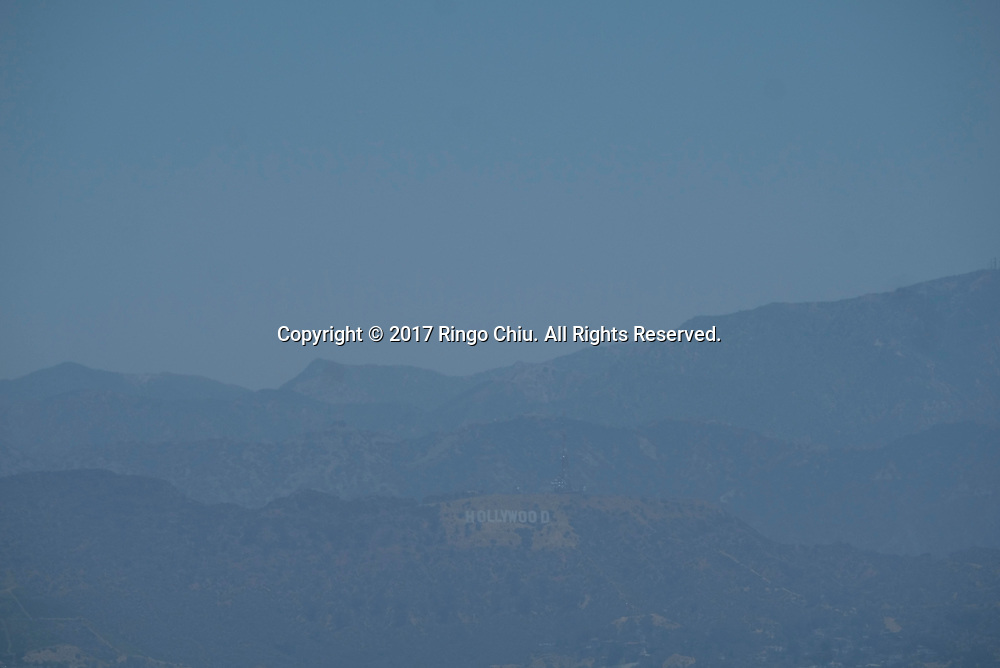 Smog shroud the Hollywood sign in Los Angeles on June 25, 2017. (Photo by Ringo Chiu)<br /> <br /> Usage Notes: This content is intended for editorial use only. For other uses, additional clearances may be required.