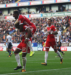 Britt Assombalonga of Middlesbrough (Top) celebrates after scoring his sides second goal with Adama Traore - Mandatory by-line: Jack Phillips/JMP - 09/09/2017 - FOOTBALL - Macron Stadium - Bolton, England - Bolton Wanderers v Middlesbrough - English Football League Championship