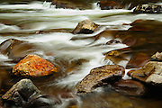 The little river runs over the rocks at Cades Cove in the Great Smokey Mountains, Tennessee