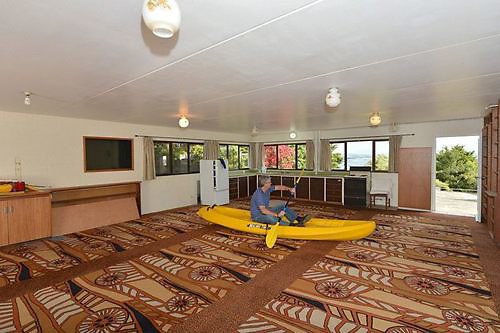 Who'd live in a house like this? Worst estate agent pictures show off homes with Swastikas on the wall, smashed windows and animal trophy heads <br /> <br /> With broken windows, overgrown gardens and bedrooms that could easily double as prison cells, theses shocking properties would prove a hard sell for the most gifted of estate agents.<br /> Even silver-tongued salesmen would struggle to shift these homes with what must be some of the world's worst estate agent photographs.<br /> One includes a tiled Swastika in a bathroom, another pictures a dog using a back lawn as a toilet and a third shows a chilling message written in red paint warning guests that 'you will die'.<br /> Others show stuffed animals and creepy-looking dolls and masks while there are also images of smashed windows, bizarrely positioned toilets and terrible paint jobs.<br /> The images were compiled from around the world by Andy Donaldson of Terrible Estate Agent Photos and are due to appear in a new book.<br /> &copy;terriblerealestateagentphotos.com/Exclusivepix