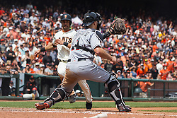 SAN FRANCISCO, CA - APRIL 24: J.T. Realmuto #11 of the Miami Marlins tags out Angel Pagan #16 of the San Francisco Giants at home plate during the fifth inning at AT&T Park on April 24, 2016 in San Francisco, California.  (Photo by Jason O. Watson/Getty Images) *** Local Caption *** J.T. Realmuto; Angel Pagan