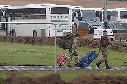 © licensed to London News Pictures. London, UK 18/07/2012. Two soldiers arrive to the military base in Hainault Country Park in Redbridge, east London. The base will accommodate 3,000 soldiers during the Olympics. Photo credit: Tolga Akmen/LNP