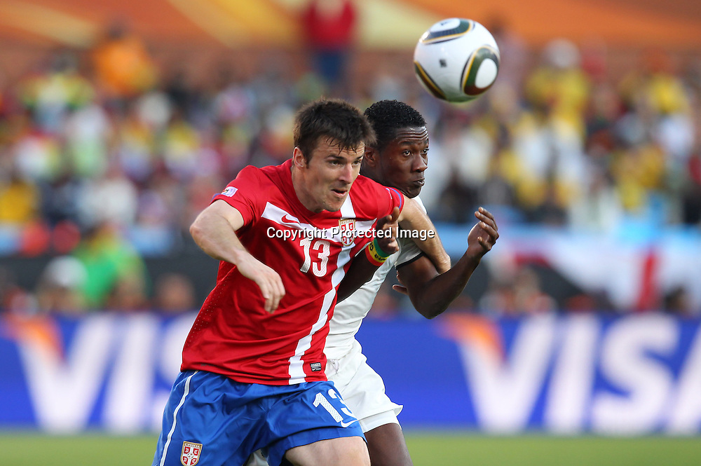 (L to R) <br /> Aleksandar Lukovic (SRB), <br /> Asamoah Gyan (GHA), <br /> JUNE 13, 2010 - Football : <br /> 2010 FIFA World Cup South Africa <br /> Group Match -Group D- <br /> between Serbia 0-1 Ghana <br /> at Loftus Versfeld Stadium, Pretoria, South Africa. <br /> (Photo by YUTAKA/AFLO SPORT) [1040]