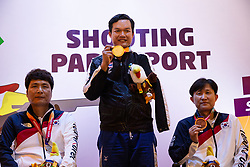 October 12, 2018 - Jakarta, Jakarta, Indonesia - Jakarta, Indonesia, 12 October 2018 : CHAICHAMMAN ANUSON from Thailand (midldle) on receiving Gold Medal after win the R4-Mixed 10M Air Rifle Standing. Para Asian Games shooting competition at Gelora Bung Karno sports center-Jakarta. (Credit Image: © Donal Husni/ZUMA Wire)