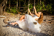 Bride on a tree swing at the beach on fitzroy island