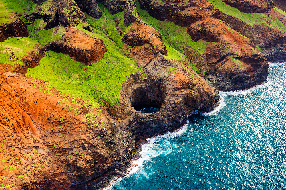 The Bright Eye open ceiling sea cave on the Na Pali Coast (aerial), Napali Coast Wilderness State Park, Kauai, Hawaii USA