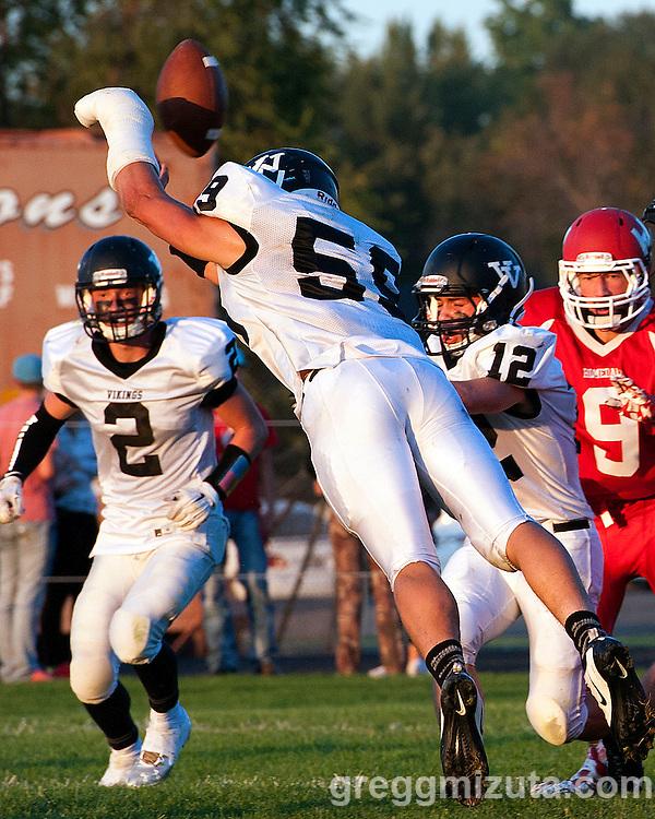 Garret DeVos blocks a PAT. Vale - Homedale football game, September 11, 2015 at Homedale High School, Homedale, Idaho. Homedale won 40-7.