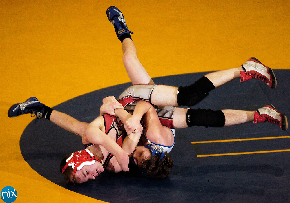 Mount Pleasant's Matt Newman wrestles South Stanly's John Hoezle Wednesday night in Mount Pleasant.
