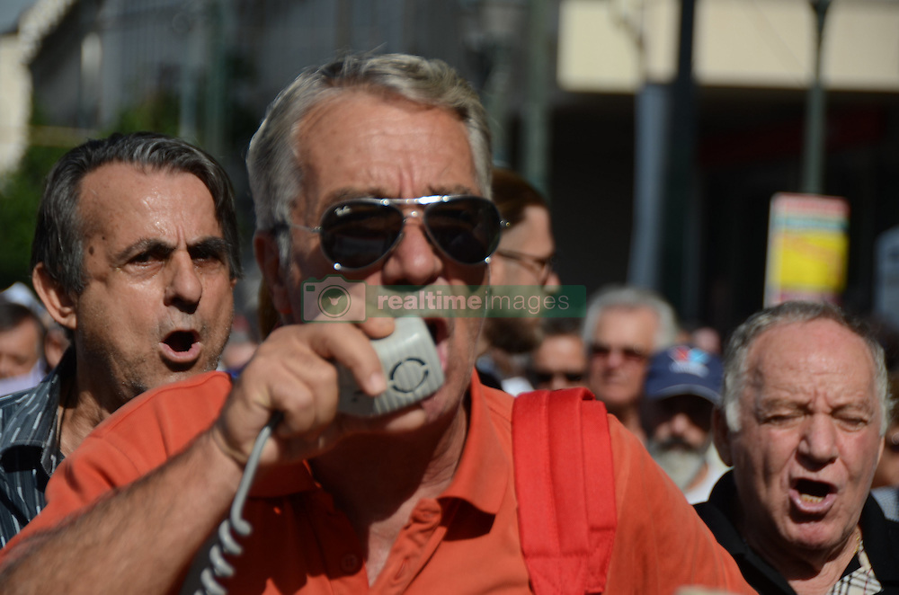 October 3, 2016 - Athens, Greece - Demonstrator uses a megaphone to shout anti goverment slogaqns..Greek pensioners demonstrate in Athens against the goverment cuts on pensions and their benefits in General. Demonstrators clashed with riot policve after they found the road to Prime Ministers office closed by police. (Credit Image: © George Panagakis/Pacific Press via ZUMA Wire)