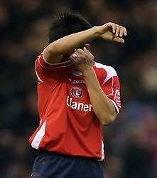 WEST BROMWICH, ENGLAND - Saturday, December 15, 2007: Charlton's Zhi Zheng looks dejected after his side's 4-2 defeat against West Bromwich Albion during the League Championship match at the Hawthorns. (Photo by David Rawcliffe/Propaganda)