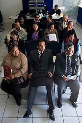 People wait to be attended inside of the customer service office of the Tax Administration Service on Thursday, October 22, 2009.