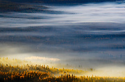 Overlooking the Yaak Valley at sunrise in fall. Kootenai National Forest in the Purcell Mountains, northwest Montana.