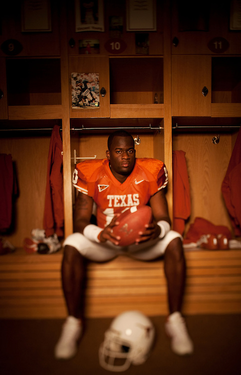 Vince Young, Quarterback #10, University of Texas Longhorns. Photographed in the Texas Locker Room at Darrell K. Royal-Texas Memorial Stadium  on July 25, 2005. Photograph © 2005 Darren Carroll